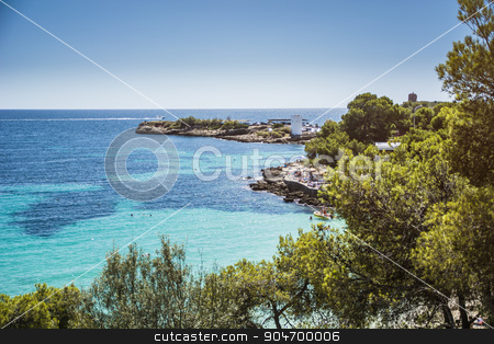 Isolated Beach and Rocky Coast, Ibiza, Spain stock photo, Overview of Isolated Deserted Sand Beach Along Rocky Cliff Lined Coast with Turquoise Waters on Coast of Ibiza, Spain on Sunny Day with Yachts in Distance by Stefano Cavoretto