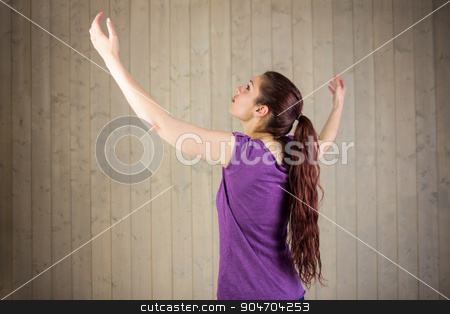 Woman with arms raised  stock photo, Woman with arms raised while standing at home by Wavebreak Media