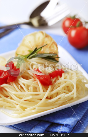Vegetarian appetizer stock photo, Spaghetti, peeled tomato and baked garlic -  detail by Digifoodstock