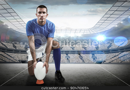 Composite image of full length portrait of rugby player placing  stock photo, Full length portrait of rugby player placing ball against rugby stadium by Wavebreak Media
