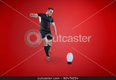 Composite image of rugby player kicking the ball stock photo, Rugby player kicking the ball against red background by Wavebreak Media
