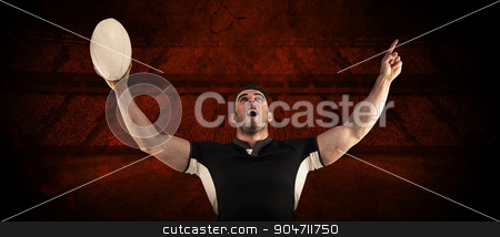 Composite image of rugby player cheering with the ball stock photo, Rugby player cheering with the ball against rugby stadium by Wavebreak Media