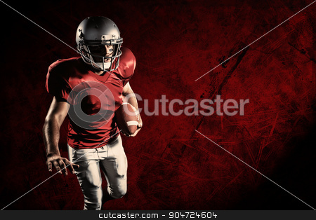 Composite image of sportsman running while playing american foot stock photo, Sportsman running while playing American football against dark background by Wavebreak Media