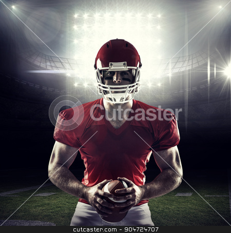 Composite image of american football player holding ball stock photo, American football player holding ball against american football arena by Wavebreak Media