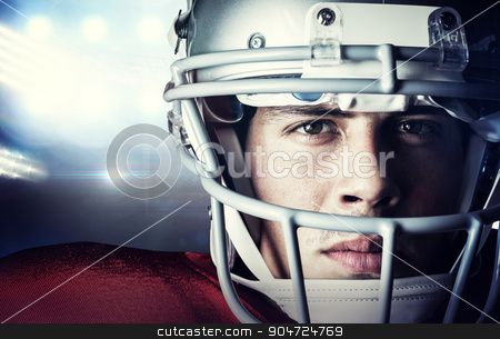 Composite image of close-up portrait of confident sportsman stock photo, Close-up portrait of confident sportsman against american football arena by Wavebreak Media