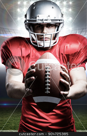 Composite image of portrait of determined american football play stock photo, Portrait of determined American football player holding ball against american football arena by Wavebreak Media