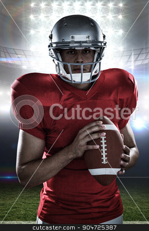 Composite image of portrait of confident sportsman with american stock photo, Portrait of confident sportsman with American football against american football arena by Wavebreak Media