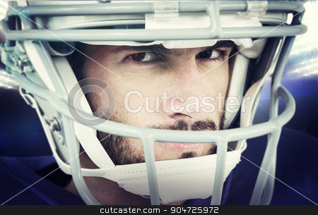 Composite image of close-up portrait of stern american football  stock photo, Close-up portrait of stern American football player against american football arena by Wavebreak Media