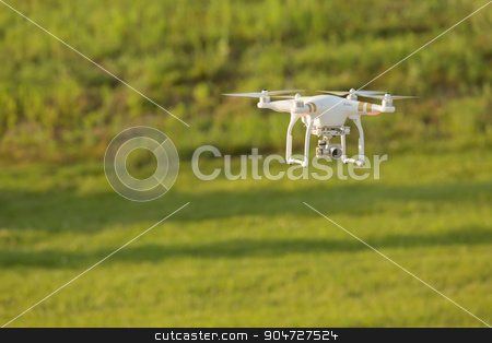 Drone Above Field stock photo, Remote control drone flying in mid air over a field by Scott Griessel