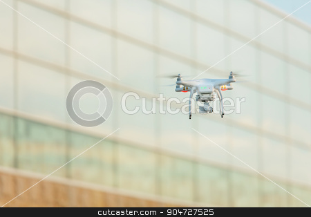 Flying Drone stock photo, Single remote control drone flying in mid air by Scott Griessel