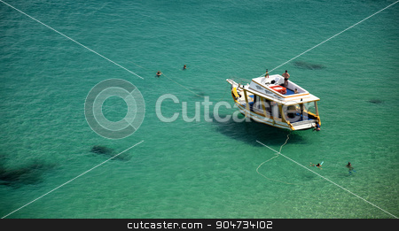 Boat in a Crystalline sea beach in Fernando de Noronha,Brazil stock photo, Boat in a Crystalline sea beach in Fernando de Noronha,Brazil by Elder Vieira Salles