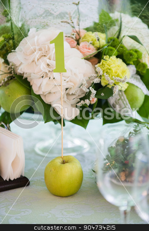 Summer table setting in green with apple stock photo, Summer table setting in green by Dmytro Bartosh
