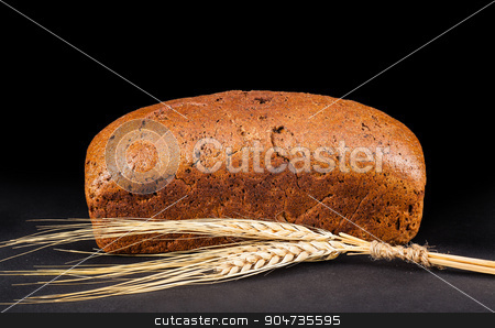 brown bread with ears of wheat  stock photo, brown bread with ears of wheat on a dark background by MegaArt