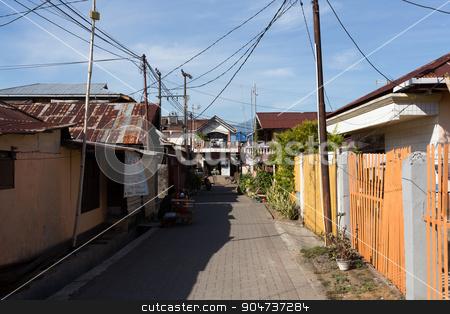 Manado shantytown street North Sulawesi stock photo, MANADO, NORTH SULAWESI, INDONESIA - AUGUST 5, 2015:  Manado shantytown street on August 5, 2015 in Manado, North Sulawesi, Indonesia by Artush