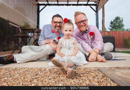Gay Couple with Little Girl stock photo, Happy same sex couple sitting with daughter outdoors by Scott Griessel