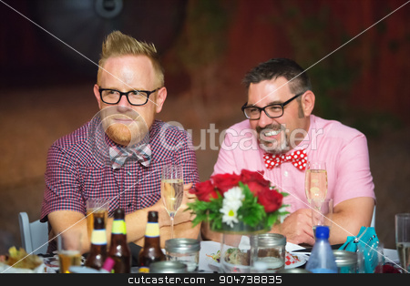 Gay Couple Drinking Wine stock photo, Gay couple drinking wine at reception table by Scott Griessel