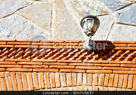 rocks stone and red street lamp stock photo, rocks stone and red orange gneiss in the wall of morocco by mason luca