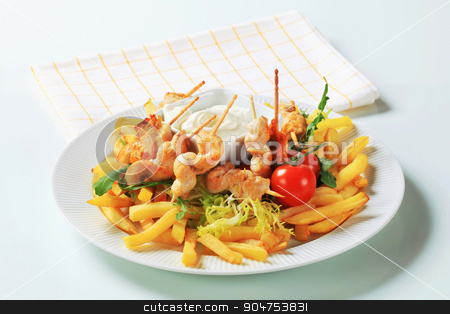 Chicken satay with French fries stock photo, Chicken satay with French fries and tartar sauce by Digifoodstock