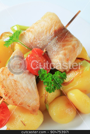Fish skewer and potatoes stock photo, Fish skewer and potatoes - detail by Digifoodstock