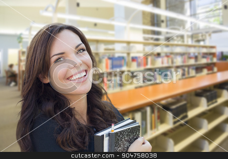 Mixed Race Girl With Books in the Library stock photo, Happy Mixed Race Girl With Books in the Library. by Andy Dean