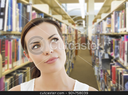 Mixed Race Girl Looking to the Side in the Library stock photo, Curious Mixed Race Girl Looking to the Side in the Library. by Andy Dean