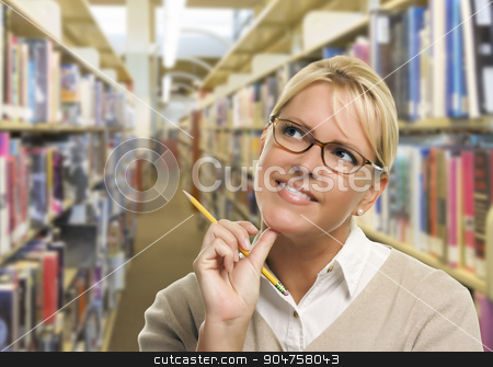Woman with Pencil Looking to the Side in Library stock photo, Pretty Woman with Pencil Looking to the Side in the Library. by Andy Dean