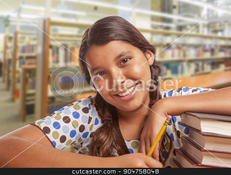 Hispanic Girl Student Studying in Library stock photo, Happy Hispanic Girl Student with Pencil and Books Studying in Library. by Andy Dean