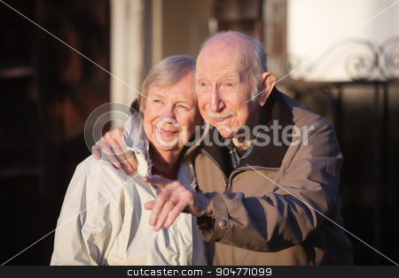 Man Pointing with Girlfriend stock photo, Handsome senior man pointing at something with his girlfriend by Scott Griessel