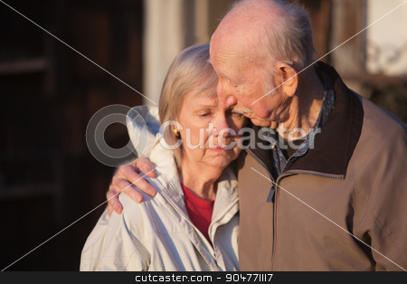 Man Comforting Sad Woman stock photo, Sympathetic man with uneasy senior woman outdoors by Scott Griessel