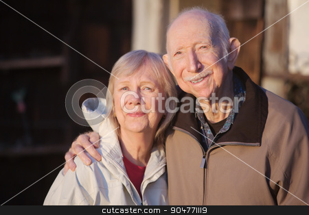 Grinning Older Partners stock photo, Happy male and female partner embracing outdoors by Scott Griessel