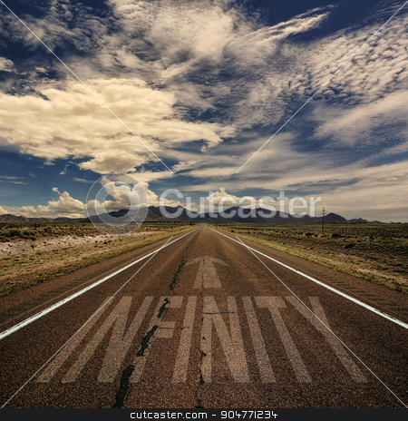 Infinity Road stock photo, Conceptual image of desert road with the word infinity and arrow by Scott Griessel
