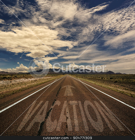 Vacation on the Road stock photo, The word vacation on an isolated desert mountain road by Scott Griessel