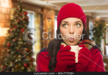 Mixed Race Woman Wearing Hat and Gloves In Christmas Setting stock photo, Warm Mixed Race Woman Wearing Winter Hat and Gloves In Christmas Setting. by Andy Dean