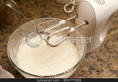 Mixing batter for baking stock photo, Mixing batter for baking in a large bowl on an electric mixer fitted with a whisk, close up view by Stephen Gibson