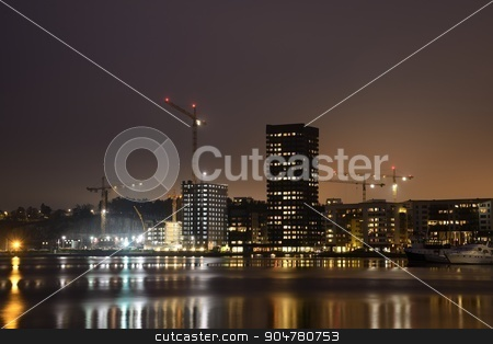 Modern apartment buildings stock photo, Modern apartment buildings in new neighborhood at night.  by a40757