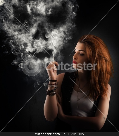 Dangerous smoking stock photo, Girl smokes a cigarette forming a skull by Federico Caputo
