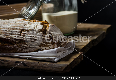 Home-baked sourdough bread stock photo, Home-baked sourdough bread, wheat-rye rustic, product photo, ready for your dark advertisment, place for text by Peteer