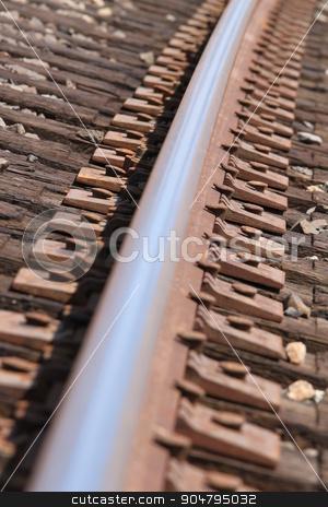 Train Track stock photo, Closeup few of a rosty train track. by Henrik Lehnerer
