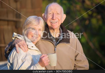Confident Senior Couple stock photo, Confident white senior citizen couple outdoors with coffee by Scott Griessel