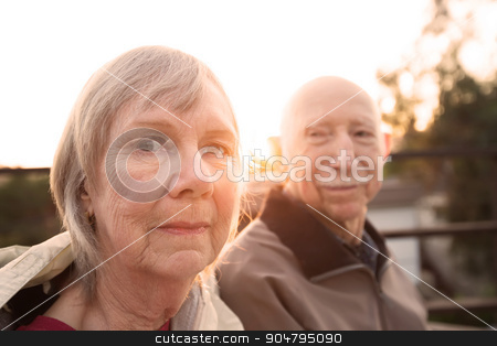 Calm Older Couple stock photo, Calm Caucasian senior couple sitting together outdoors by Scott Griessel