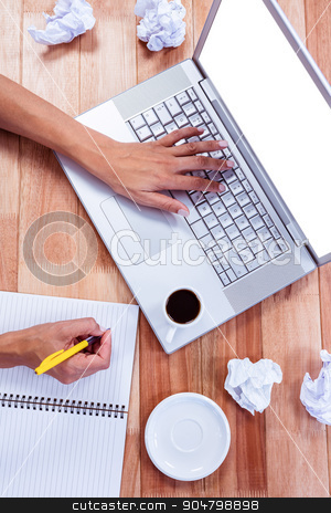 Part of hands typing on laptop stock photo, Part of hands typing on laptop on wooden desk by Wavebreak Media