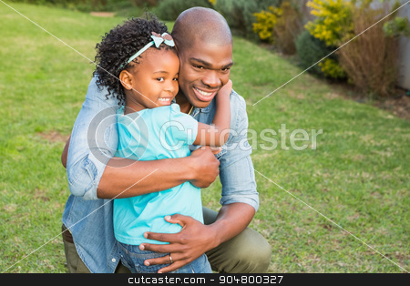 Smiling father hugging his daughter  stock photo, Smiling father hugging his daughter in the garden by Wavebreak Media