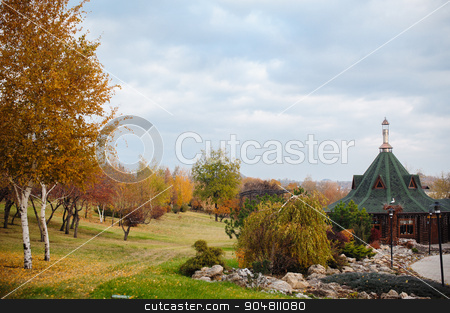 Autumn Scenery of Park Alley with Bushes and Trees on Green Grass stock photo, Autumn Scenery of Park Alley with Bushes and Trees on Green Grass. by timonko