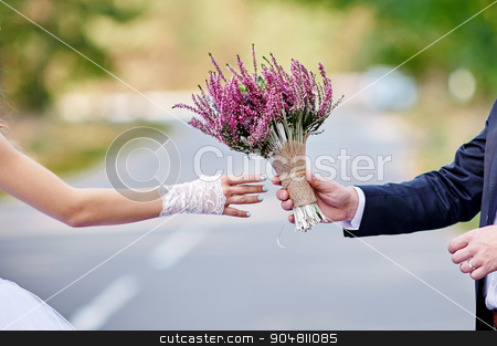 groom gives the bride a beautiful wedding bouquet stock photo, groom gives the bride a beautiful wedding bouquet. by timonko