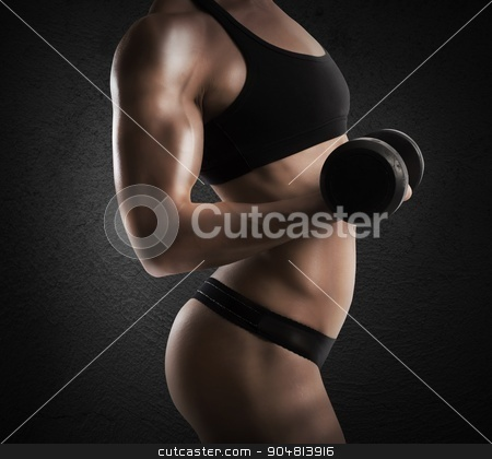 Female muscular body stock photo, Muscular woman is training with a dumbbell by Federico Caputo