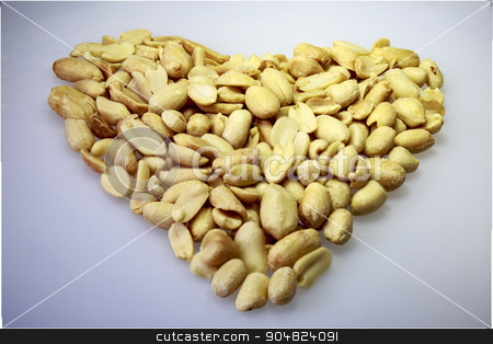 peanut stock photo, salted peanuts ripe grains on a white table by Sergey Borisov