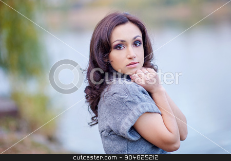 beautiful woman on the background of the lake stock photo, beautiful woman on the background of the lake. by timonko