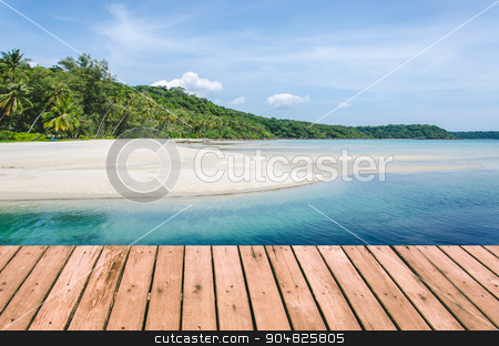 sea beaches stock photo, Tropical beach with sea wave on the sand and palm trees.Wood planks floor. Beauty nature background. by aoo3771