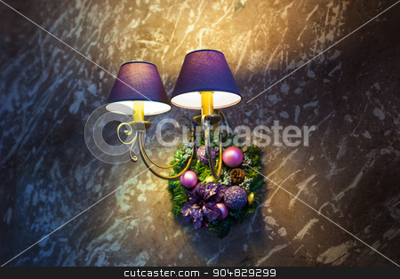 included a beautiful wall lamp and Christmas decorations stock photo, included a beautiful wall lamp in the room and Christmas decorations by timonko