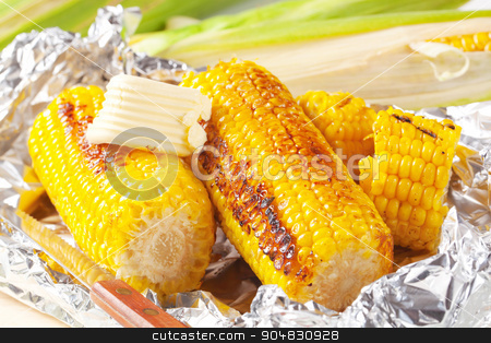 Grilled corn stock photo, Pieces of sweet corn grilled in tin foil by Digifoodstock